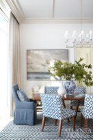 The custom rug in the dining room has seven shades of blue that Andrew Howard continued throughout the condo. The seascape painting is a reminder of the owner's hometown of Jacksonville, Florida, and is from Mrs. Howard in Atlanta. Side chairs, Mitchell Gold + Bob Williams in Peter Dunham.