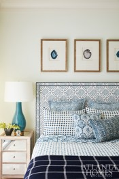 Crisp blues in the tailored guest room create a lively mix of patterns and chic accents. Bedding, Les Indiennes.