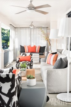 Fabrics by Jim Thompson, Porter Teleo, Perennials and Link Outdoor add graphic and colorful whimsy to the front porch of the renovated Virginia-Highland home.