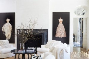 A pair of large-scale paintings by Atlanta artist Todd Murphy presides over the fireplace and adds an element of movement to this serene corner of the living room.