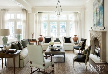 """""""As a designer, I don't want any room to feel too precious,"""" interior designer Barbara Westbrook says. """"Today, people want to live in every room of the house."""" In the living room, seating groups (a mix of custom, Bungalow Classic and B.D. Jeffries pieces) encourage lingering conversation and inviting warmth when family and friends gather."""