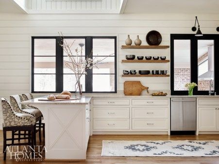 In the renovated kitchen, a specialty black finish on the windows anchors the new shiplap wall.