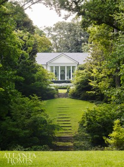 """""""People know this house as it is viewed from Habersham Road. Nestled into the landscape and mostly hidden by trees, one can see only a small jewel box of a portico from the street, which is precisely how we wanted to build it back. Luckily, most of the vegetation around the house remained intact,"""" says Dixon."""