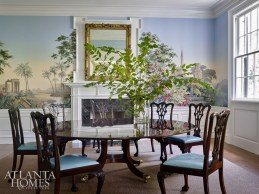 """""""In the previous dining room, all the trim work was stained, and we suggested they go with a painted chair rail and wainscoting and painted a chimney breast to offset the new zuber wallcovering."""""""