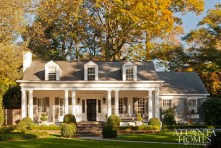 "William B. Litchfield and Jackye Lanham refreshed this 1938 Colonial Revival cottage with a light palette and period-appropriate architectural details inside to ""charm the house up,"" says Litchfield."