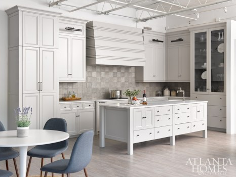 A kitchen vignette in Bell Kitchen & Bath's new, 3,000-square-foot ADAC West showroom features custom cabinetry by Bell, Avenza honed marble countertops, a corded tile backsplash from Renaissance Tile & Bath and a hidden pantry.