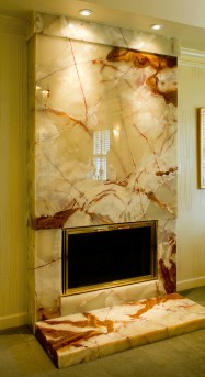 This polished onyx fireplace and hearthstone by James L. Stack Fine Marble & Granite Fabrication became an instant conversation piece. Photography by Chris Schultz.