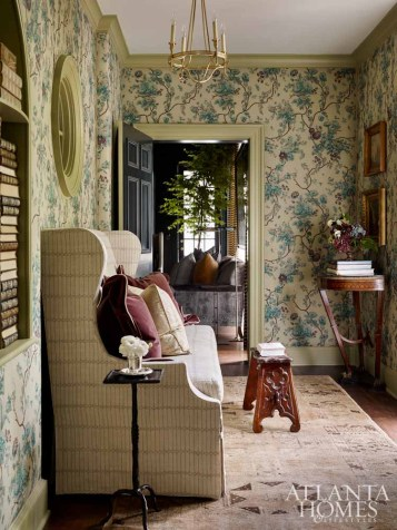 Gothic arches are a subtle but sophisticated addition to the newly renovated residence, paying homage to an architectural element found in the original residence. Here, an arched nook received new life in the master passage; Braund fills it with a library of antique books to add character to its storied appeal.