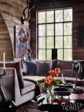 Architect Yong Pak and builder Michael Ladisic officially outdid themselves with this lofty man cave, which boasts plenty of natural light and views of Nancy Creek below. Employing reclaimed barn board from a rural property owned by the homeowners, and coupled with arched ceilings and steel-framed doors, its rustic-meets-elegant effect is nothing short of surprising at every turn.