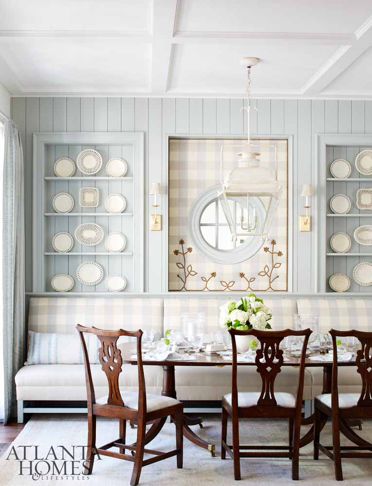 Dining area with pale blue walls, white china, banquette seat and Hepplewhite chairs