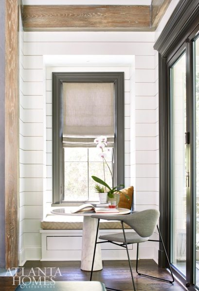 The Musso-designed bistro table, here executed in marble, creates an intimate work area when pulled up to a window seat.