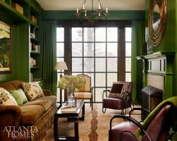 For quieter moments, the homeowners can retreat to the richly layered library. While smaller in scale than the home's other rooms, it's not short on personality or comfort. A custom emerald-green lacquer on the walls and a faux antelope carpet make for a stunning combination without detracting from the room's greatest feature: the mountain views.