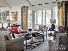 Pretty and Practical The living room blends comfortable seating, such as swivel chairs and a custom sectional (all in muted tones by Edward Ferrell) with perky pillows in a lively Travers print.
