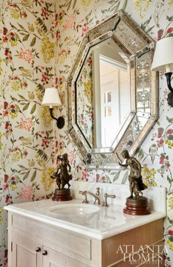 Bright Side A Nina Campbell wallcovering adds vibrancy to the main level powder.