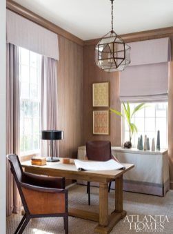 Turner transformed the room just off the entryway into a cozy study since the Plumbs plan to use the beach retreat as their primary residence. Washed oak paneling gives the room warmth, while a desk from Century Furniture provides the perfect place to catch up on emails.