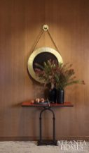 An Avrett mirror hangs above a leather top table by Soane.