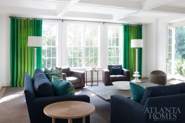 The verdant palette continues into the family room with shades of Kelly and apple green.