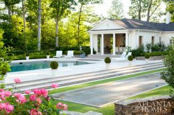 The pool was completely updated, and a bocce ball court was a part of the redesign. Boxwoods give a structed look to the garden spaces while roses add an exuberant note.