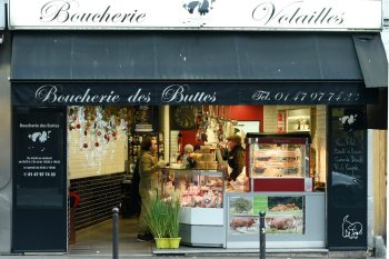 Paris A Dream food tour introduces guests to culinary experts, including local butchers in a Belleville, Paris, boucherie.