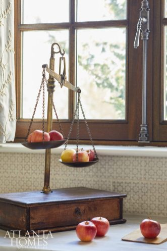 An antique kitchen scale from Foxglove Antiques adds a touch of whimsy in the kitchen.