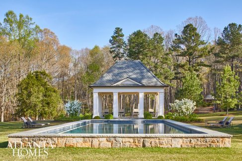 Spanning 20 acres, the home's grounds were transformed into an outdoor oasis by landscape architect Richard Anderson, architect Yong Pak and builder Alan Webster. Here, a stately pool house, showcasing Pak's trademark attention to symmetry and detail, holds court in the backyard.