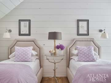 Beyond a sliding barn door is the guest suite, which beguiles with touches of lavender and architectural drawings from John's university days.