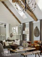 Adams introduced more natural light into the family room by placing dormers on either side of the vaulted ceiling. To add warmth, the ceiling is accented by timber trusses, which were sourced by the homeowner, who retired recently from the building industry.