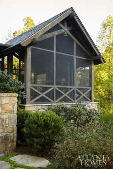 A screened porch is a cozy landing spot year-round, and offers lake views.