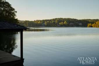 The rear porch of this lakeside home offers scenic views.