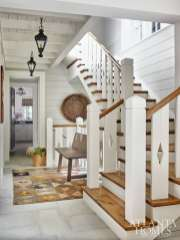 The staircase features a modern take on pickets.