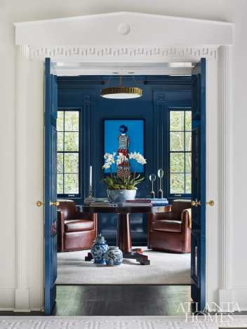 A photograph by Erik Madigan Heck, through Jackson Fine Art, holds court in the lacquered reading room.