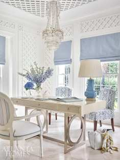 The lady's parlor doubles as a home office with a Bernhardt desk and slipcover chairs featuring an eye-catching Cowtan & Tout fabric.