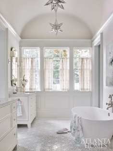 Significant renovations to the master bath introduced an arched ceiling and new windows. The towels are D. Porthault through Gramercy Fine Linens.