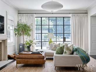 Embracing the couple's former California lifestyle, the family room takes on a more relaxed ambience.