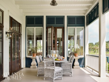 A series of mahogany doors connecting to the combination living-and-dining room not only doubles the entertaining space but gives the couple's little loved ones more space to play and explore. The wicker chairs are from Lloyd Flanders' Mackinac collection.