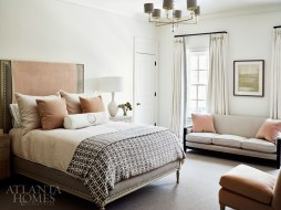 Lush texture and subdued hues create a restful oasis in the light-filled guest bedroom.