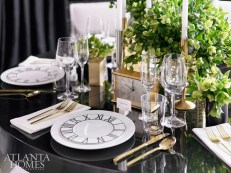 Modern Mikasa Winslet accent plates are paired with everyday Wedgwood china in a timeless table setting with gold flatware from West Elm and Riedel crystal.