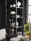 A black étagère from Baker's Barbara Barry Collection keeps desserts, coffee and Champagne on hand.