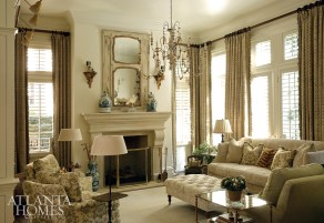 The living room is equal parts inviting and chic. Here, a subtle Suzanne Tucker floral covers a pair of tight-back armchairs, and reappears once more on accent pillows on the sofa. The Vaughan chandelier is from Ainsworth-Noah. The 19th-century trumeau mirror and a number of accessories from House of Hazen make for perfect conversation pieces.