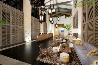 The hotel's spacious and bright lobby is a study in laid-back luxury.