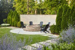 "The firepit, set off by a curved wall, serves as a natural destination point for outdoor entertaining. ""From the natural world, there are two things that people love. They love water. They love fire,"" says Bill Caldwell, director of Harrison Design's Landscape Architecture Studio."