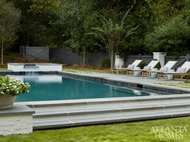 """""""We use the outdoor space all the time, and I love the bluestone floors,"""" says Hight. """"And the pool is great because my three children are all swimmers."""" Landscape Architecture by Bellwether Landscape Architects."""