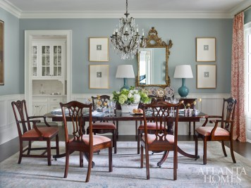 """""""So many pieces in my house are from Scott's,"""" says homeowner Jane Hight of the dining room's ornate mirror and chandelier."""