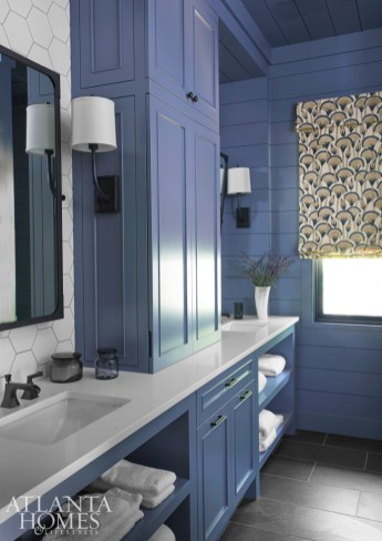 A guest bath features slate tile floors and a large-scale hexagon ceramic tile backsplash from Renaissance Tile & Bath.