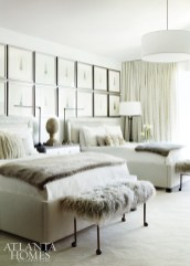A grouping of paintings of feathers creates a striking moment in her bedroom.
