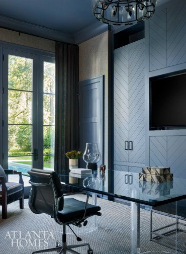 Although the home's layout offers a great sense of openness, its design also called for pockets of private spaces, such as the husband's office.