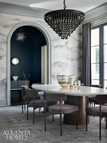 A striking, digitally printed wallcovering from Phillip Jeffries' Beyond collection sets the stage for chic entertaining in the dining room. Other unique accents include a cascading chandelier from Restoration Hardware and an oversize rug from Moattar, Ltd. The chairs are by Mitchell Gold + Bob Williams.