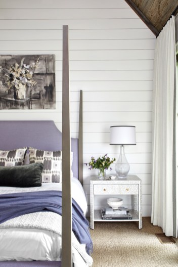 While lavender accents bring a fun, feminine flair to the daughter's bedroom, clean lines—from the Mitchell Gold + Bob Williams bed to the inlay end table by Made Goods—make the space fit for guests of any age. The quilt is Roberta Roller Rabbit and the art was purchased at Trinity School's Spotlight on Art Artists Market.