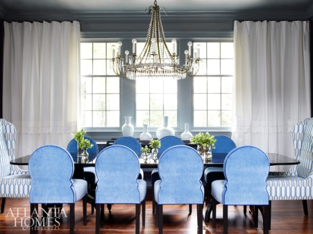 Douglass kept the dining room's existing chandelier and used its form as inspiration. Custom chairs sidle up to a black lacquer table from Holland & Company. Silk drapes and decorative objects, South of Market.