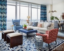 Cool neutrals lay the groundwork for eclectic patterns in the living/dining room. The draperies feature Jim Thompson's Otago fabric while the rug is custom by Eliko. The garden stool is from One Kings Lane.